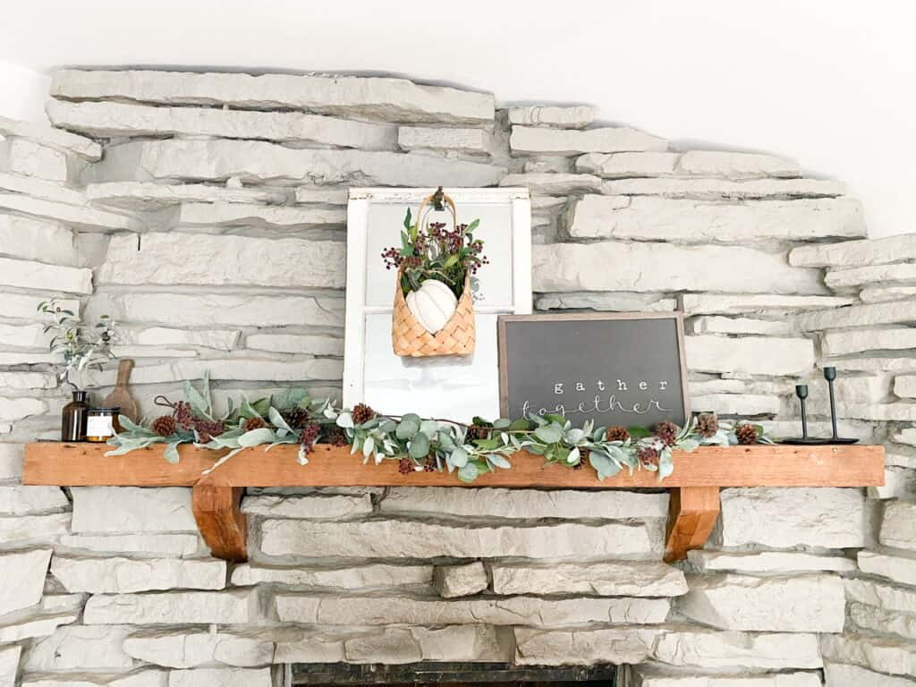 Fireplace mantle with muted fall decor. The perfect way to add some color to your neutral fall decor