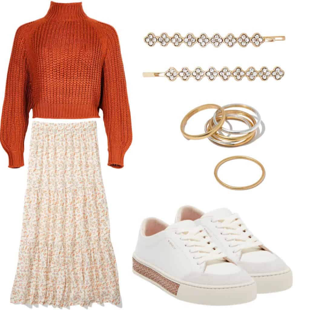 These casual Thanksgiving outfits will have you looking good and feeling comfortable. This outfit features A cropped orange mock neck sweater with a light floral midi skirt, some white leather sneakers with pink detailing along the soles, gold and silver thin stacking rings, and some gold and rhinestone bobbi pins.