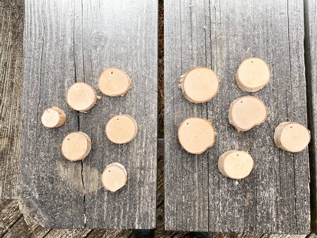 Slices of birch branches with holes drilled about 1?4 inch from the top.