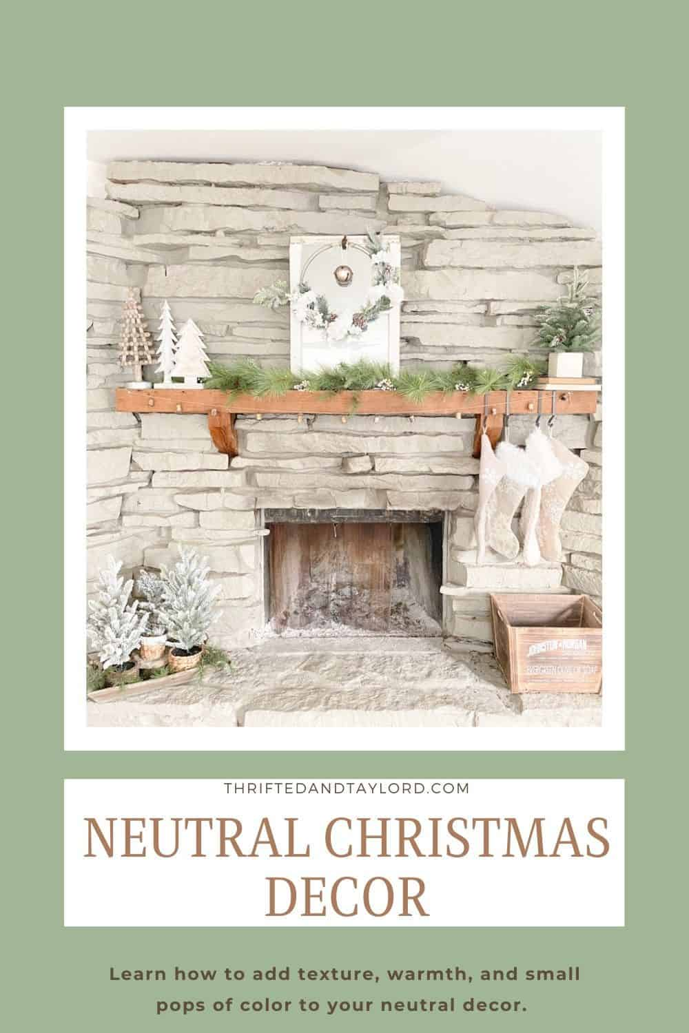 Image shows a fireplace with neutral Christmas decorations.
