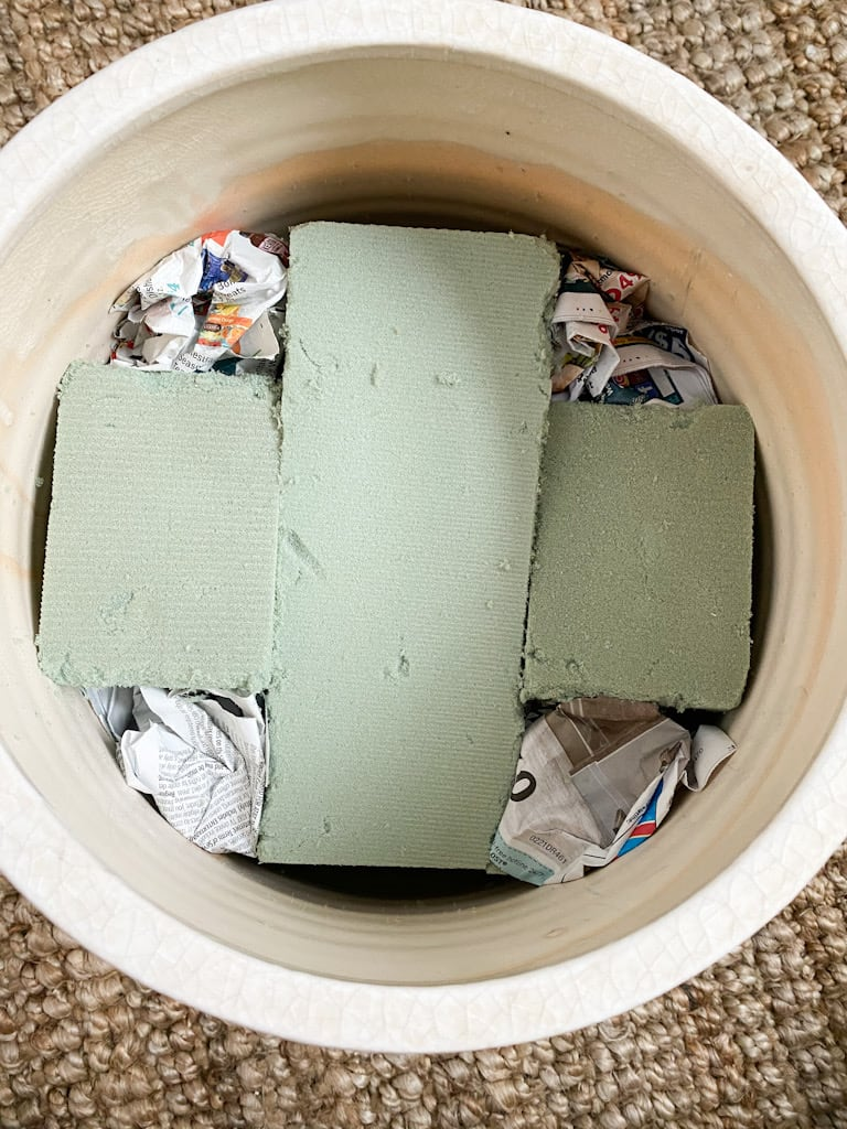 The inside of the pot after I filled in the holes with recycled newspapers.