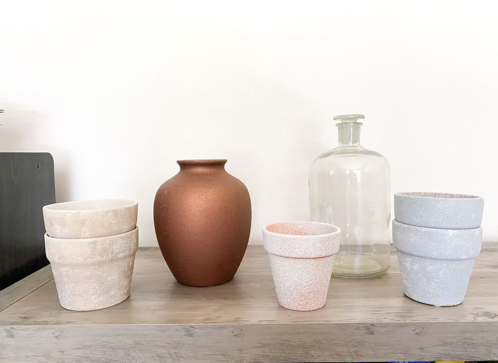 How all of the upcycled vases and pots looked before being painted.
