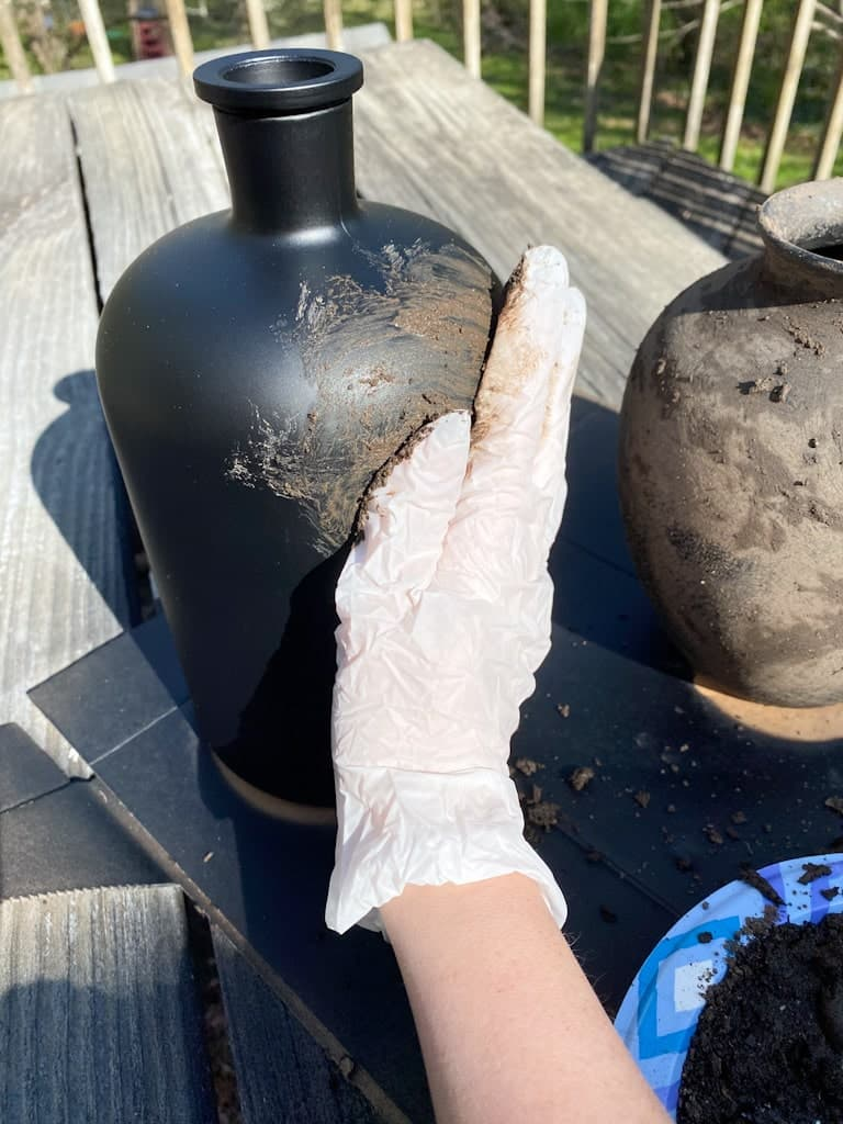 Using a glove I rubbed the mud onto my upcycled vases.
