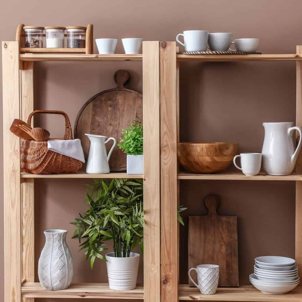 Wooden shelves with a variety of white kitchen ware mixed with wood kitchen items and 2 plants in white pots.