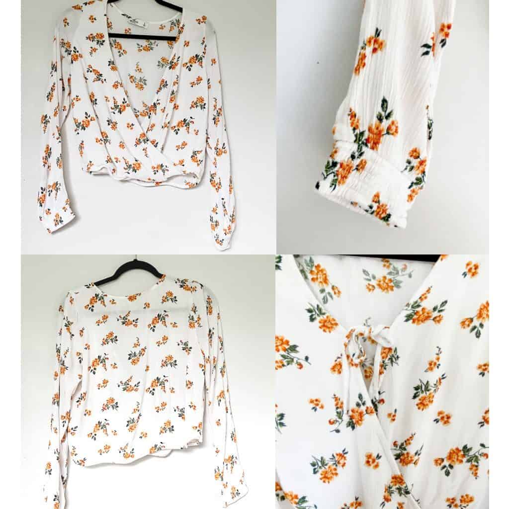 A white tie front long sleeve top with small orange flowers.